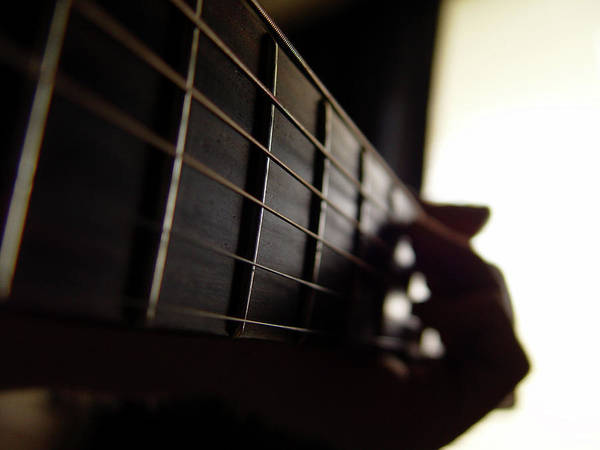 Chord Wall Art - Photograph - Fingers On Fretboard by Jackvalley