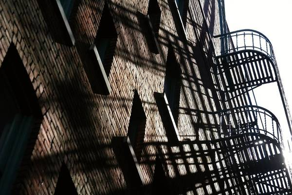 The Weather Photograph - Fire Escapes And Old Brick by Linus Gelber / Alert The Medium