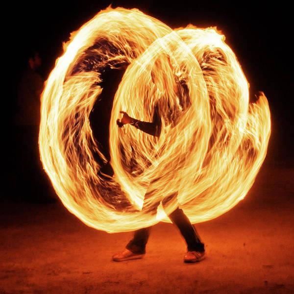 Wall Art - Photograph - Fire Performer Spinning Fire Ropes by Tristan Savatier