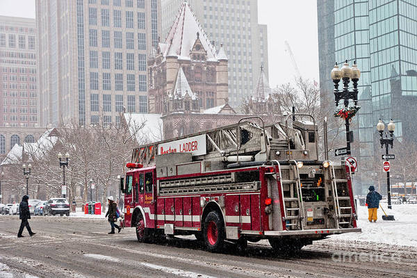 Photograph - Fire Truck Traveling The Snowy Streets Of The City. by Joaquin Corbalan
