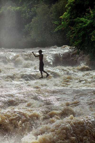 Real People Photograph - Fisherman Crosses Mekong River On High by Timothy Allen