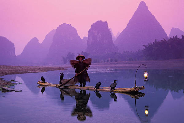 Raft Photograph - Fisherman On Bamboo Raft With by Keren Su