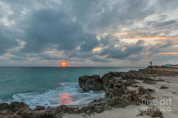 Photograph - Fisherman On Rocks by Tom Claud