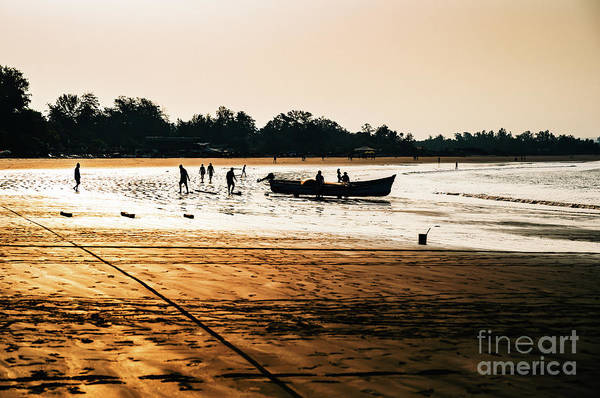 Photograph - Fishermen At Morjim Beach by Miles Whittingham