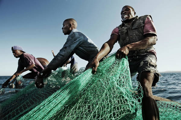Pulling Photograph - Fishermen Pulling In Net In Water by Cultura Rm Exclusive/led