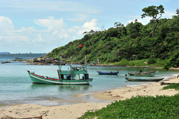 Fishing Boat Photograph - Fishing Boats In Cove And Beach by Christophe cerisier