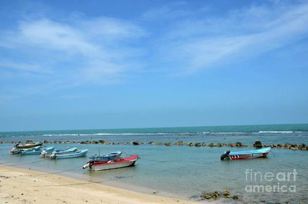 Photograph - Fishing Motor Boats Parked In Shallow Water Beach Jaffna Peninsula Sri Lanka by Imran Ahmed