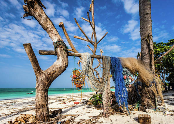 Photograph - Fishing Nets Drying On The Beach by Lyl Dil Creations