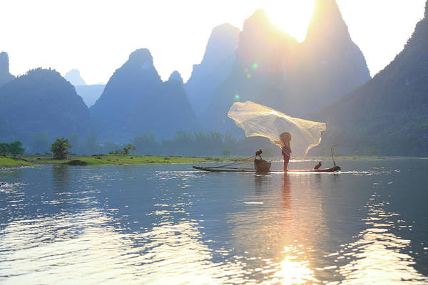 Awe Photograph - Fishing On The Li River by Bihaibo