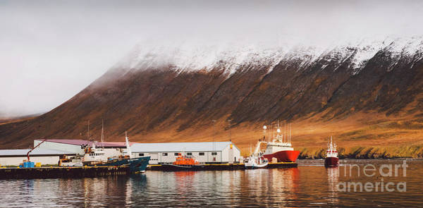 Photograph - Fishing Port Of The Village Of Seydisfjordur, In Iceland, With Vibrant Colors And Reflections In The Sea Of Fishing Boats. by Joaquin Corbalan