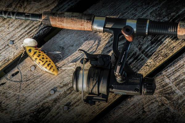 Wall Art - Photograph - Fishing Rod With Spinning Reel And Jitterbug Crank Bait On A Boa by Randall Nyhof