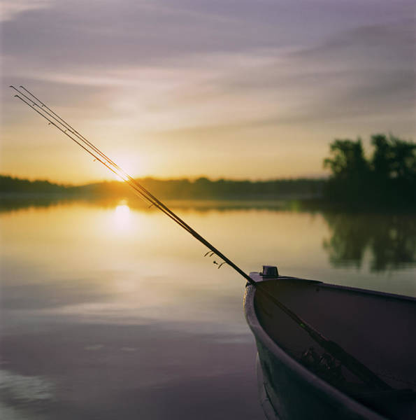 Fishing Boat Photograph - Fishing Rods In Boat At Sunset by Anne-marie Weber