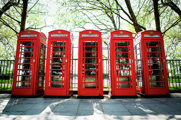 English Culture Photograph - Five Red Telephone Boxes In A Line by Richard Boll