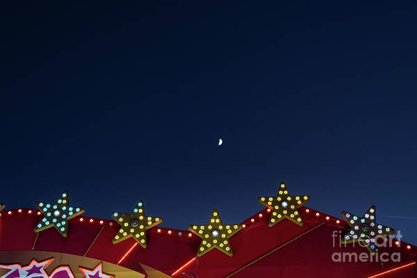 Photograph - Flat Background Of Blue Sky With Small Moon And Luminous Light Bulbs. by Joaquin Corbalan