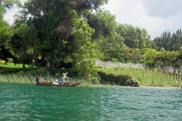 Wall Art - Photograph - Floating Down The Lake In Guatemala by Douglas Barnett