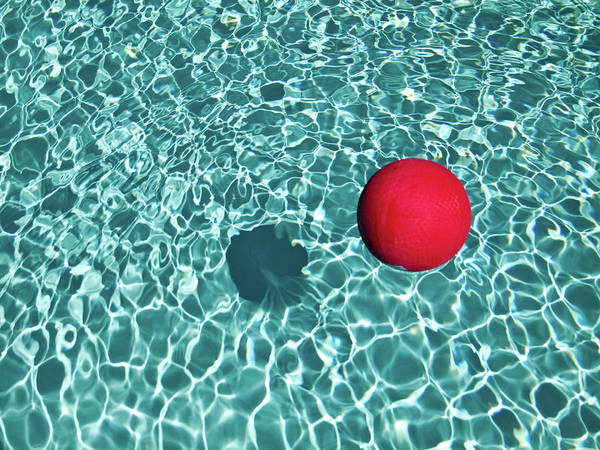 Floating Red Ball In Blue Rippled Water Art Print