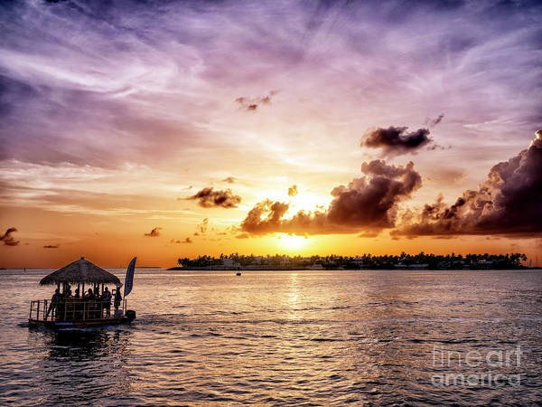 Photograph - Floating Tiki Bar At Sunset In Key West by John Rizzuto