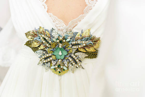 Photograph - Flower Shaped Brooch Made With Small Gemstones For A Wedding Dre by Joaquin Corbalan
