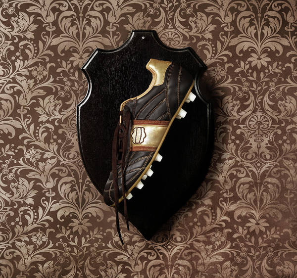 Photograph - Football Boot Hanging As A Trophy On A by Henrik Sorensen