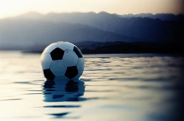 Shadow Photograph - Football Floating In Water by Ghislain & Marie David De Lossy