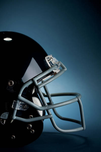 Football Helmet Photograph - Football Helmet On Blue by Sean Locke
