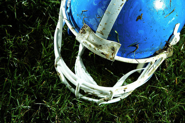 Football Helmet Photograph - Football Helmet On Grass by Thomas Northcut