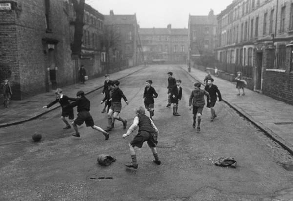 Wall Art - Photograph - Football In Street by Haywood Magee