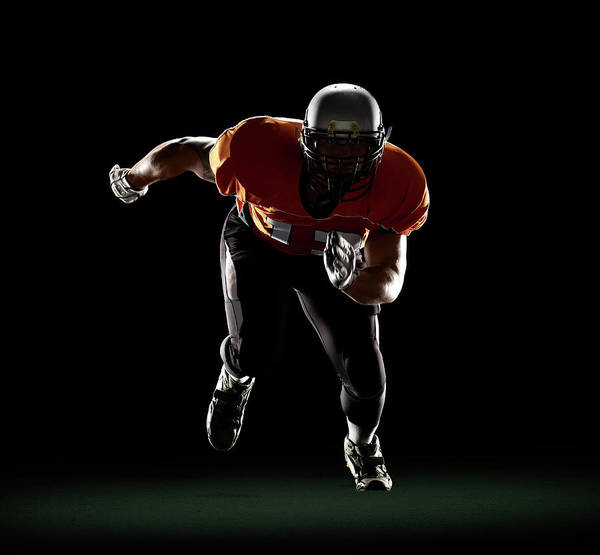 Football Helmet Photograph - Football Player Exploding From 3-point by Lewis Mulatero