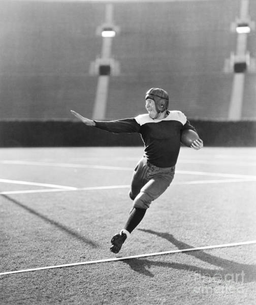 Young Man Wall Art - Photograph - Football Player Running With Ball by Everett Collection