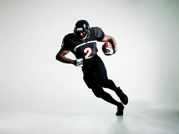 Football Helmet Photograph - Football Player Running With Ball by Thomas Barwick