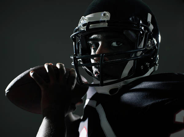 Football Helmet Photograph - Football Quarterback Preparing To Throw by Thomas Barwick