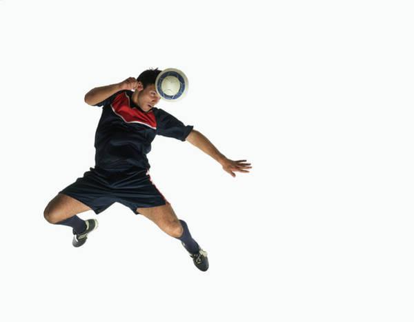 Photograph - Footballer Heading Ball In Mid-air by John Lamb
