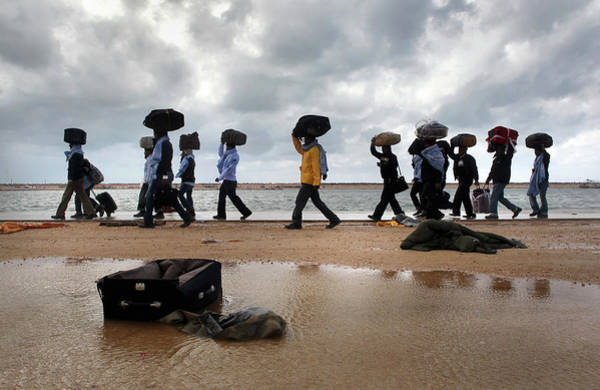 Photograph - Foreign Workers Remain Stranded In Libya by John Moore