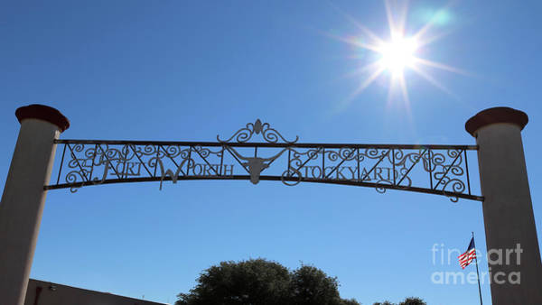 Photograph - Fort Worth Stockyards Sign With Sunshine by Carol Groenen