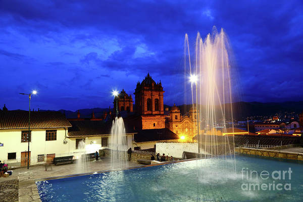 Photograph - Fountain And Cathedral Tower At Twilight Cusco Peru by James Brunker