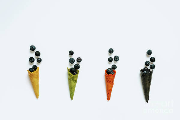 Photograph - Four Ice Cream Waffle Cones Of Different Colors Stuffed With Blu by Joaquin Corbalan