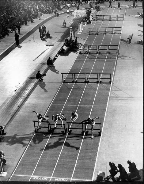 Photograph - Four Runners Clearing Hurdles In 60-yard by Gjon Mili