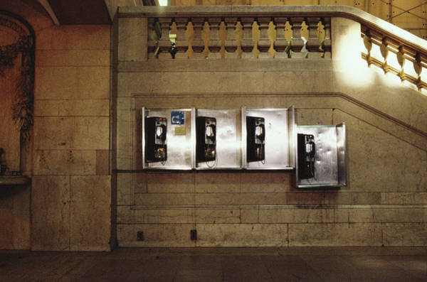 Pay Photograph - Four Telephone Booths On Marble Wall by Herb Schmitz
