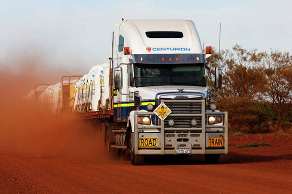 Wall Art - Photograph - Freightliner Road Train Truck On Dusty Red Outback Australian Road Pilbara Western Australia by imageBROKER - Paul Mayall