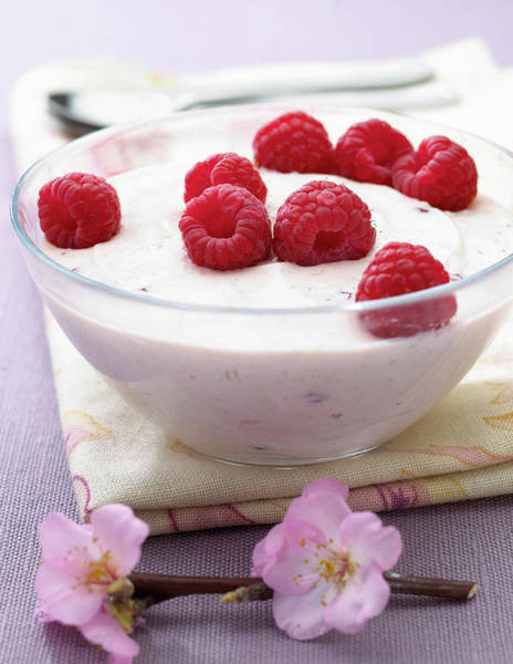 German Food Photograph - Fresh Raspberries On Soft Curd Cheese by Jupiterimages