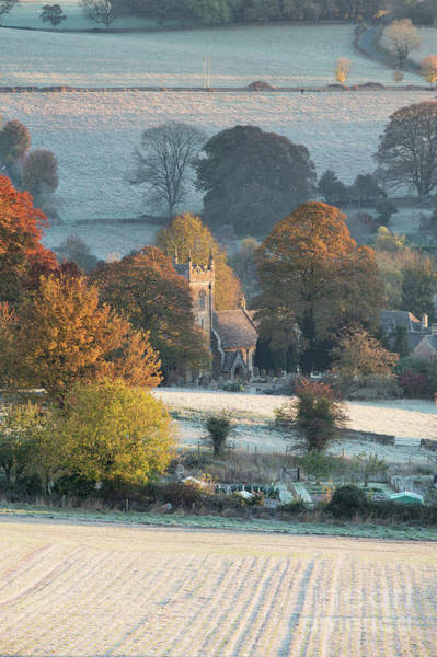 Wall Art - Photograph - Frosty Autumn Sunrise Overlooking St Peter's Church In Upper Slaughter by Tim Gainey