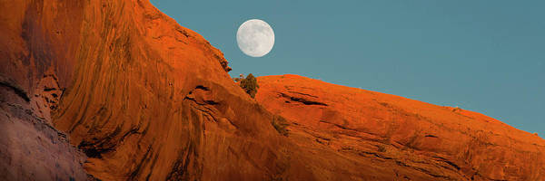 Wall Art - Photograph - Full Moon Glowing Over Rock Formation by Panoramic Images