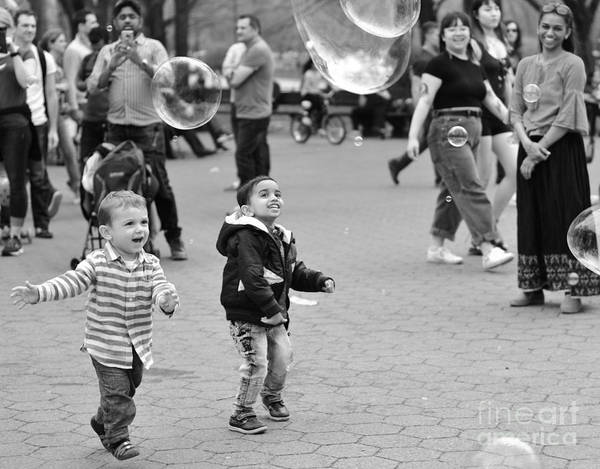 Wall Art - Photograph - Fun With Bubbles - Central Park In Spring by Miriam Danar