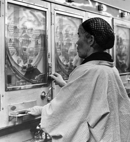 Traditional Clothing Photograph - Gambling Granny by Three Lions