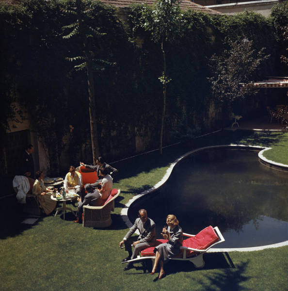 Lounge Chair Photograph - Garden In Madrid by Slim Aarons