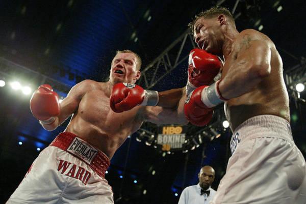 Super Sport Photograph - Gatti And Ward Trade Punches by Al Bello