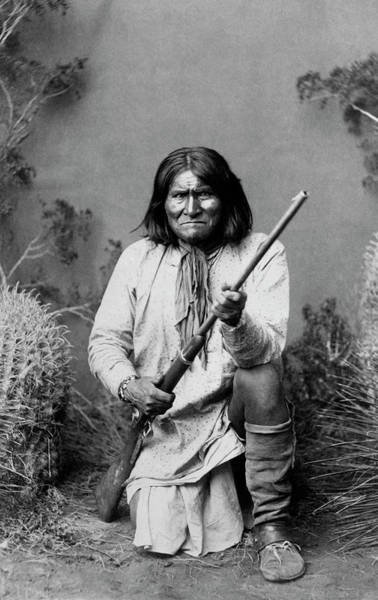 Wall Art - Photograph - Geronimo Kneeling With Rifle - 1886 by War Is Hell Store