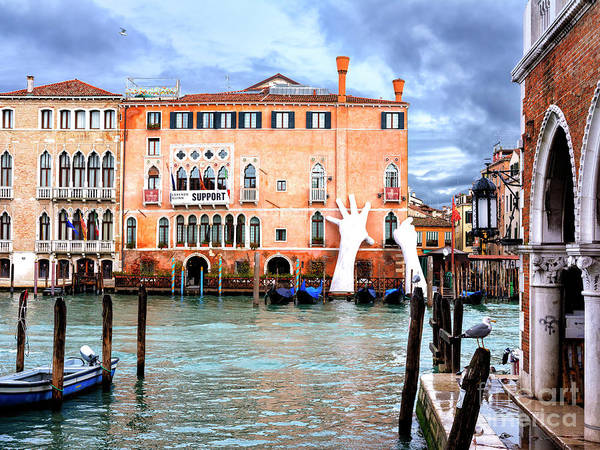 Photograph - Giant Hands Along The Grand Canal In Venice by John Rizzuto