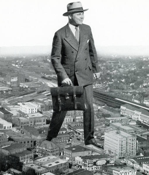 Confidence Photograph - Giant Salesman And City by Graphicaartis