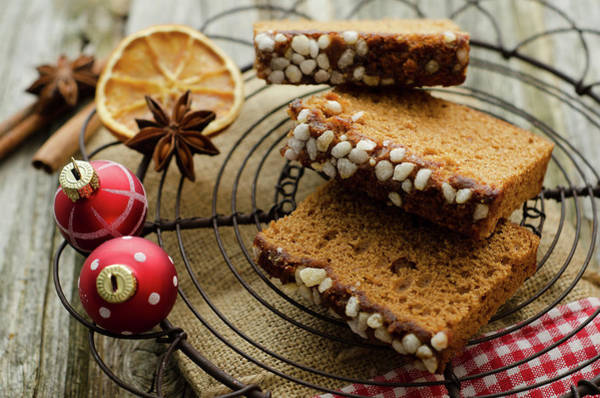 Slice Photograph - Gingerbread Cake With Christmas Baubles by Westend61